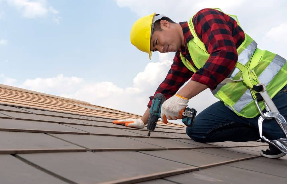 Wearing protective gear while working on your roof is a must.